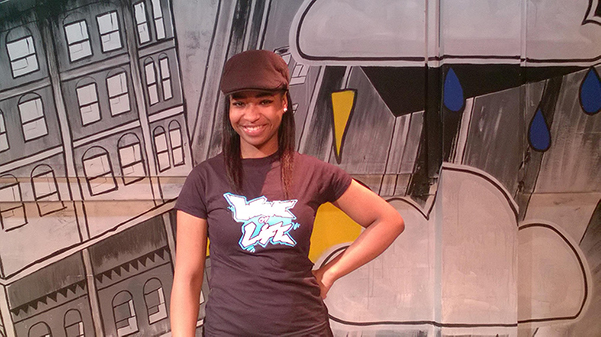 young woman in cap and second wave t shirt